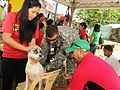 A Purok Abanico health worker, left, from the San Pedro barangay and U.S. Army Sgt. 1st Class Brian M. Reed, center, the civil affairs team sergeant with the Combined Joint Civil Military Operations Task Force 120413-A-YK011-004.jpg