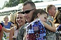 A U.S. Airman from the 169th Fighter Wing holds a child after returning from Iraq Aug. 29, 2010, at McEntire Joint National Guard Base, S.C 100829-F-XH297-009.jpg