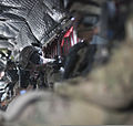 A U.S. Soldier, center left, bows his head aboard a CH-47 Chinook helicopter en route to a counterinsurgency operation in Muqer district, Ghazni province, Afghanistan, Aug. 10, 2012 120810-A-NS503-024.jpg