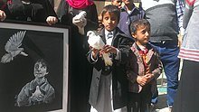 A blind child carries a dove at a protest against the attack on the al-Nour Center for the Blind in Sanaa - Yemen - 10-Jan-2016.jpg