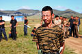 A member of the Mongolian Armed Forces is doused with pepper spray during the Non-Lethal Weapons Executive Seminar (NOLES) 2013 field training exercise Aug. 21, 2013, at the Five Hills Training Area in Mongolia 130821-M-MG222-004.jpg