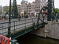 A photo of the riveted iron bascule bridge near Kadijksplein, Amsterdam; high resolution image by FotoDutch, June 2013.jpg