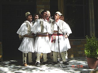 Intangible cultural heritage - Albanian polyphonic folk group wearing qeleshe and fustanella in Skrapar