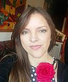 Adriana Mosquera con flor.jpg