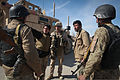 Afghan National Order Police officers coordinate a vehicle security checkpoint with U.S. Marine Corps Sgt. Timothy Guinan, military police chief, Regimental Combat Team 5, Police Advisory Team, Marjah, AF., Feb 120224-M-JI376-009.jpg