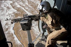 Door gunner - A door gunner operating the 7.62 GMPG over Kandahar Province, Afghanistan