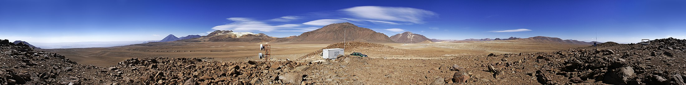 Landscape 360-degree panoramic picture of the Chajnantor plateau. In the center is Cerro Chajnantor itself. To the right, on the plateau, is the Atacama Pathfinder Experiment (APEX) telescope with Cerro Chascon behind it.[40] - Photography