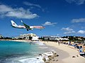 American Airlines Plane Looming Over Maho Beach (6543941141).jpg