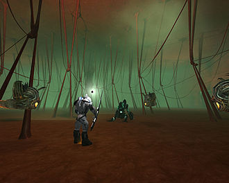 Anarchy Online - A player's character fights three computer-controlled alien enemies inside a room of an alien mothership-themed dynamic mission. Dynamic missions are a central component of Anarchy Online and each of its expansion packs.