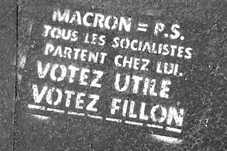 "Tactical voting - Stenciling on a Parisian sidewalk ahead of the first round of the 2017 French presidential election invoking ""votez utile"" (tactical voting) as a reason for voters to vote for François Fillon instead of Emmanuel Macron"