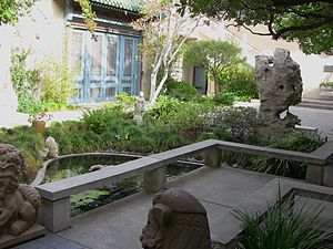 USC Pacific Asia Museum - USC Pacific Asia Museum, central courtyard with a garden, a small pool, and decorative carvings