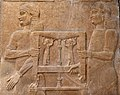 Assyrian attendants carrying a table, from Khorsabad, Iraq. The Iraq Museum.jpg