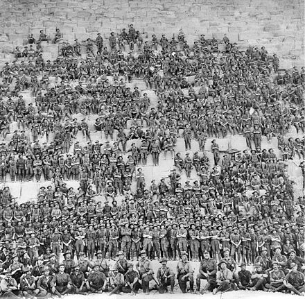 Australian 11th (Western Australia) Battalion, 3rd Infantry Brigade, Australian Imperial Force posing on the Great Pyramid of Giza on 10 January 1915 Australian 11th Battalion group photo.jpg