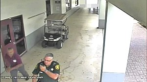 BCSO deputy Scot Peterson outside as gunman murders students inside Marjory Stoneman Douglas High School.jpg