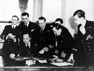 British Pacific Fleet - Melbourne, 13 December 1944. First conference of the staff of Admiral Sir Bruce Fraser's new British Pacific Fleet, held in Melbourne. Left to right: Lieutenant Commander G. P. Vollmer (Secretary to Chief of Staff); Lieutenant Commander R. N. Heard; Vice-Admiral C. S. Daniel (seated) Vice Admiral (Administration); Commodore W. G. Andrews; Captain E. H. Shattock (concealed); Captain R. C. Duckworth; Lieutenant S. G. Warrender.