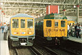 BR Class 319 EMU no. 319002 with Class 405 4-SUB no. 4732, London Waterloo, 24 October 1987.jpg