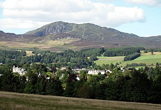 Pitlochry - Ben Vrackie, at 841m, dominates the scenery around Pitlochry. The view is from the A9 looking north and shows part of the town of Pitlochry.