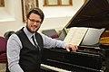 Benjamin Teague at the piano.jpg