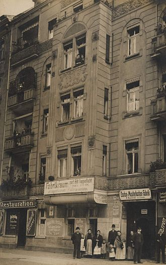Wilhelmine Ring (Berlin) - Typical Wilhelmine Ring building with shops on the ground floor and apartments in the upper storeys, from a postcard featuring Wedding around 1900