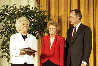 Betty Ford - Betty Ford is awarded the nation's highest civilian honor, the Presidential Medal of Freedom, by President George H. W. Bush, 1991. First Lady Barbara Bush holds the medal.