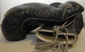 Pair of black leather boxing gloves