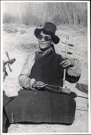 Chiwang - Acho Namgyal playing piwang in 1937