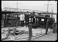 Boat docked on Potomac River; Washington Monument in background LCCN2016887253.jpg