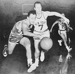 Point guard - Point guards Bob Cousy (left) and Bob McNeill (right) chase after the ball.  Cousy won six NBA championships with the Boston Celtics.