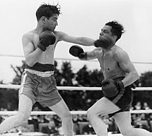 Two Royal Navy men boxing for charity. The modern sport was codified in England.