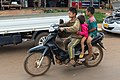 Boy riding a motorcycle with two other young children passengers, in a street of Ban Thateng Sekong Province Laos.jpg