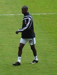A man wearing a training kit.