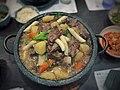 Braised beef ribs in galbi sauce (25044976362).jpg