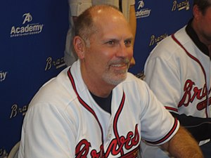 Brian Snitker - Snitker signing autographs for Braves fans in 2012