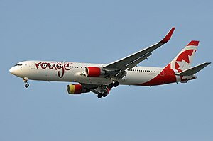Air Canada Rouge - Image: C FMXC YVR (23641586872)