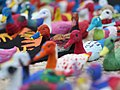 CARE International - Display of 196 papier-maché ducks painted on by 300 French children (23512935715).jpg