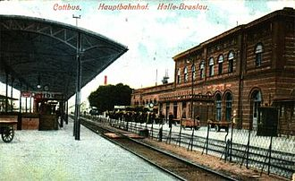 Cottbus station - Old entrance building on historical postcard. View from the platforms