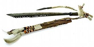Mandau (knife) - A Mandau complete with a Langgei Puai (whittling knife), pre-1927.