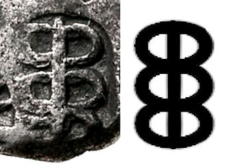 Caduceus - Caduceus symbol on a punch-marked coin of king Ashoka in India, third to second century BC