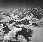 Capps and Triumvirate Glaciers, valley glaciers, bergschrund, and aretes seperating glaciers, August 26, 1969 (GLACIERS 6449).jpg