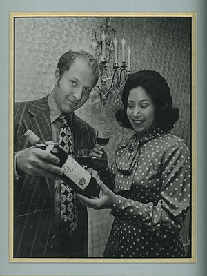 Charles Finkel - Charles and Rose Ann Finkel view a bottle of wine, circa 1972