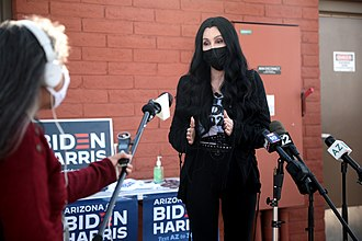Cher speaking with the media at an early voting center at Fowler Elementary School District in October 2020 Cher (50537698337).jpg