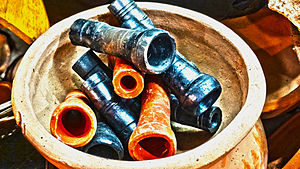 Chillum (pipe) - Traditional earthen chillum are being displayed for sale, at chawk bazar Jorhat, Assam