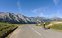 Cyclist riding down a mountain in the Pyrenees