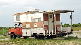 Truck camper - A truck camper customized for beach driving and offshore fishing