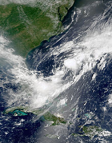 Satellite imagery showing a disorganized swirl of clouds off the coast of North Carolina.