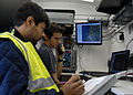 Dave Mayer and Siddartha Majumdar, both from the Center of Excellence for Airport Technology at the University of Illinois, call out radar targets to visual teams during an integration validation of avian radar 080927-N-WO977-001.jpg