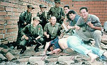 Members of Search Bloc celebrate over Escobar's body on 2 December 1993. His death ended a 16-month search effort, costing hundreds of millions of dollars.