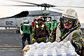 Defense.gov News Photo 110319-N-DM338-068 - U.S. sailors and Marines aboard the aircraft carrier USS Ronald Reagan load humanitarian assistance supplies onto an HH-60H Seahawk helicopter.jpg