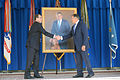 Defense Secretary Ash Carter, left, shakes hands with former Defense Secretary Leon Panetta during a ceremony for the unveiling of Panetta's portrait at the Pentagon, April 16, 2015 150416-D-LN567-037.jpg