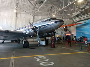 Delta Flight Museum - Delta Ship 41 in Historic Hangar 1, with the Stinson Reliant in the background.